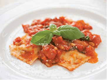 Ravioli di Ricotta, in a tomato sauce on a white plate