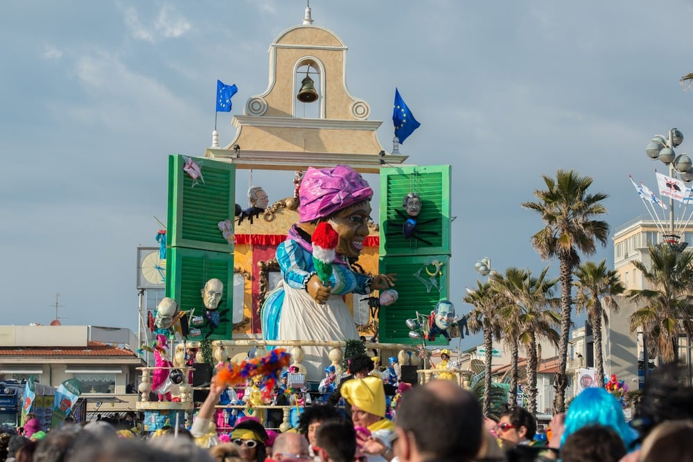 Shows carnival float with giant paper mache figure in Viareggio, Italy