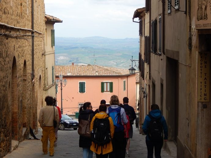 Tourists walking in Montalcino, Italy
