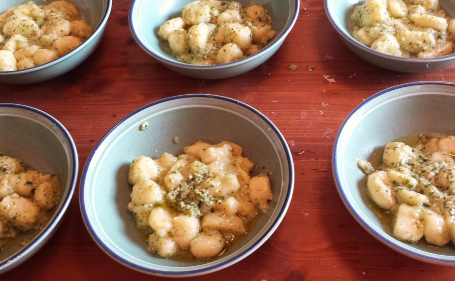 dish of gnocchi with a pesto sauce