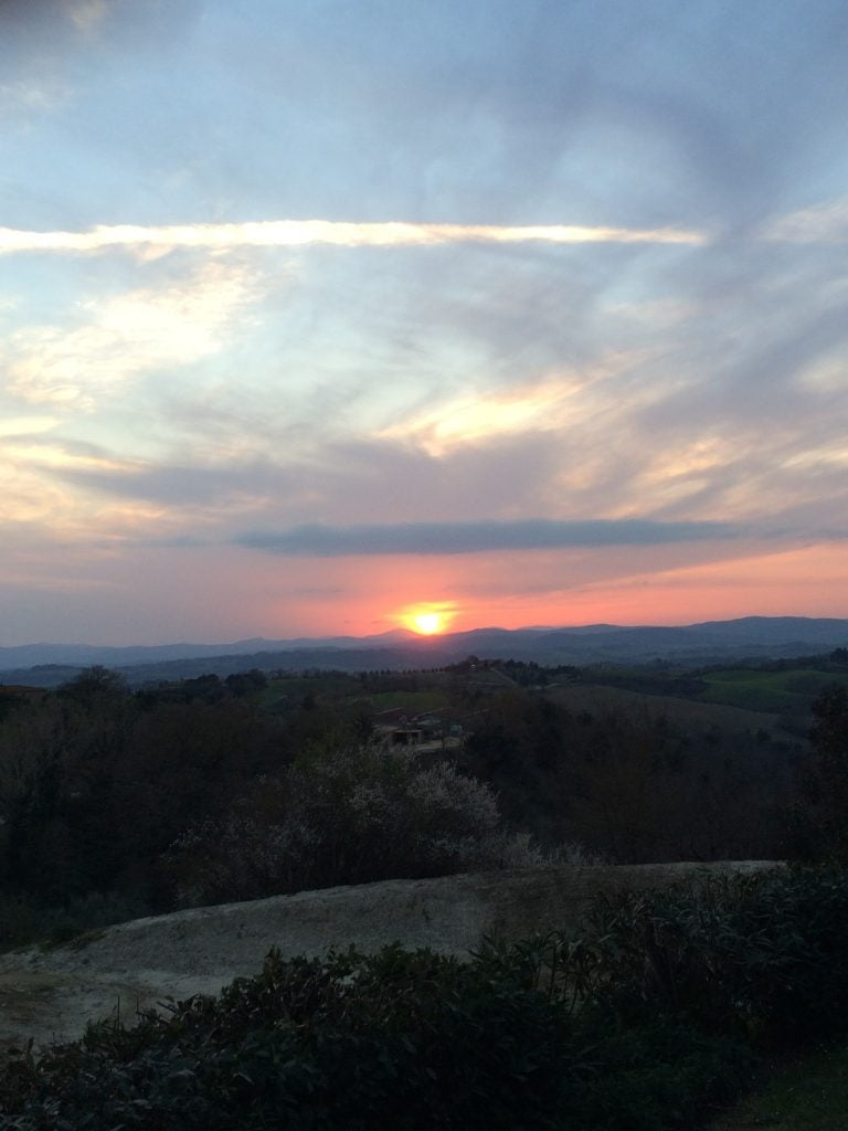 Sun setting over a Tuscan landscape