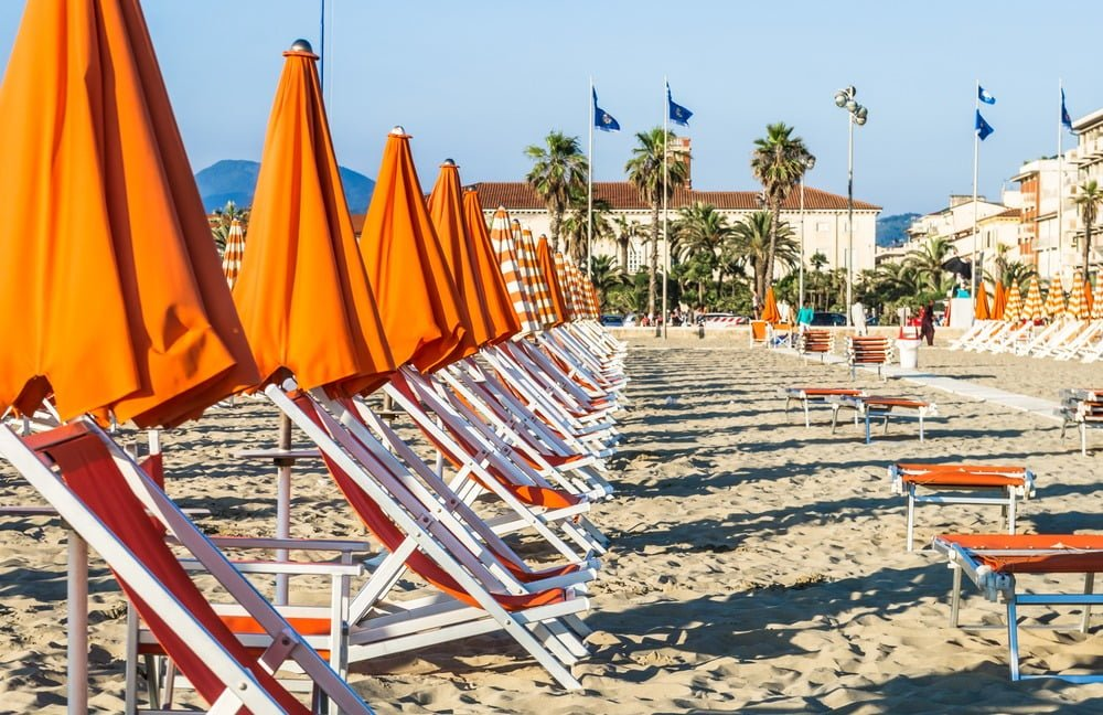 Orange beach umbrellas and loungers at Viareggio Italy