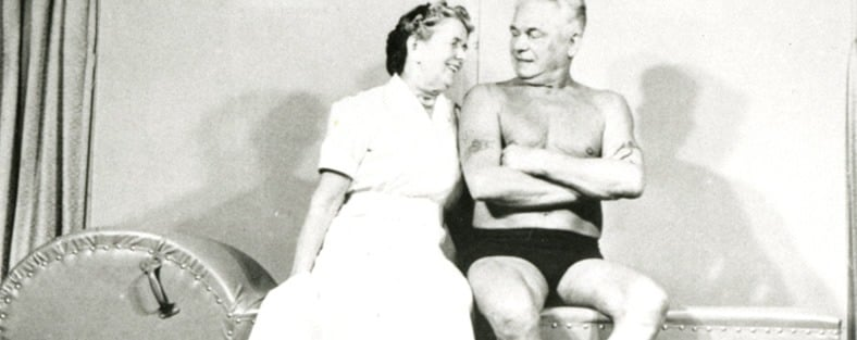 Joseph and Clara Pilates looking admiringly at each other