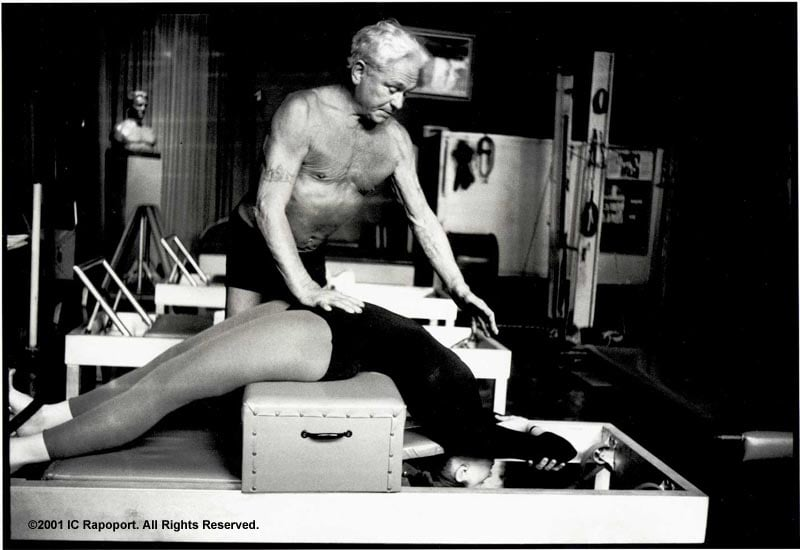 Joseph Pilates helping a student