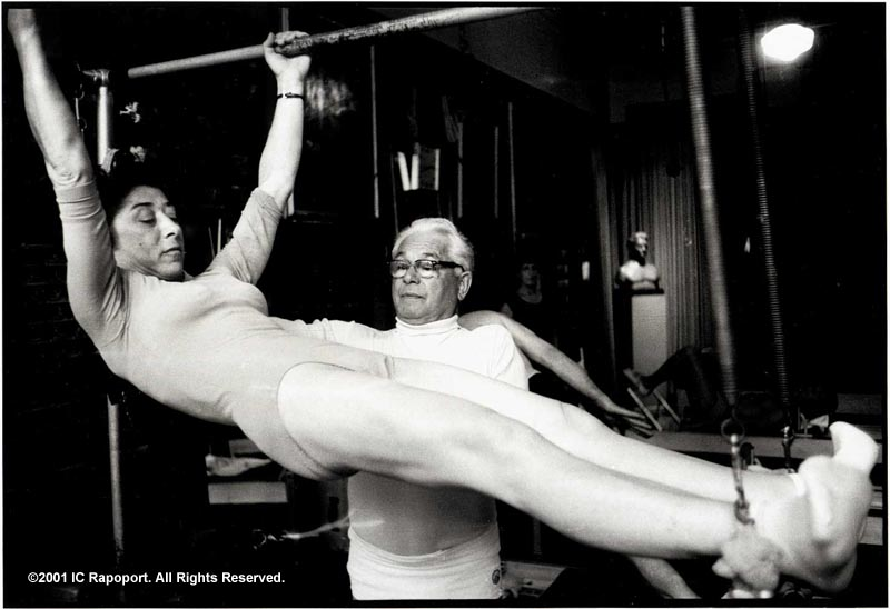 Joseph Pilates instructing a student