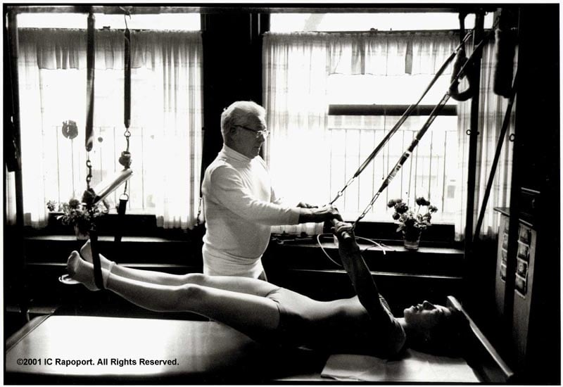 Joseph Pilates working with a student