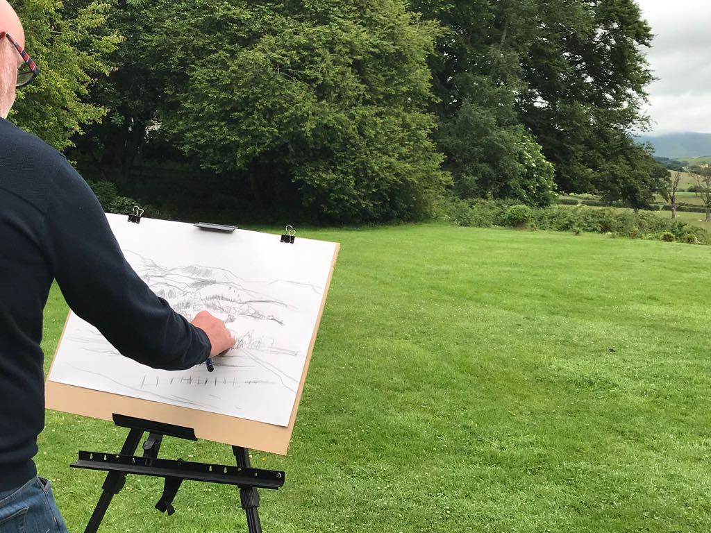 Hugh Tuckerman preparing a painting outside
