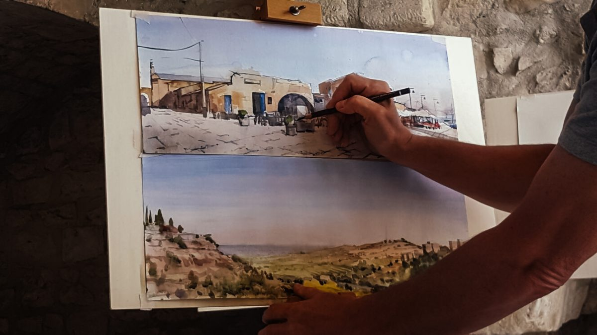 Artist puts finishing touches to landscape paintings