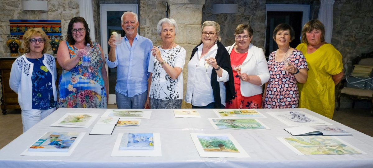 Painting group celebrating their work in Sicily