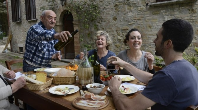 Italian family eating together at a dinner table