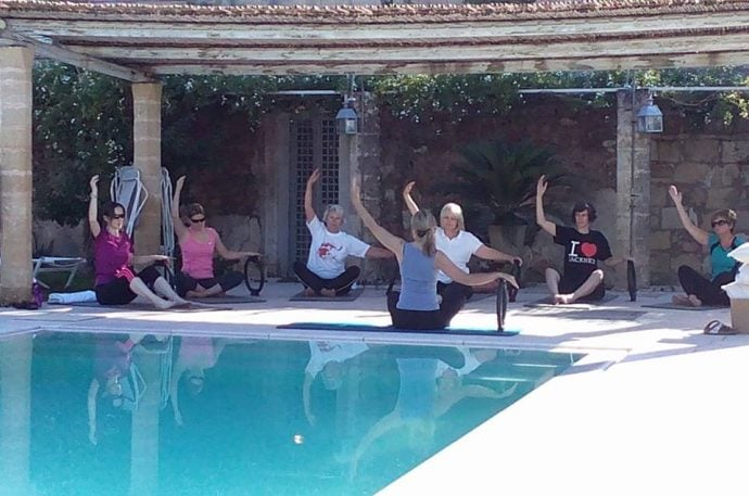 Pilates class by the pool in Italy