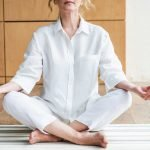 Mature woman meditating in the lotus positio