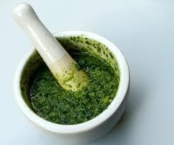Green pesto in a pestle