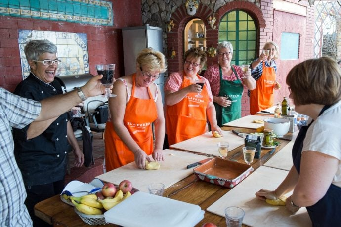 cooking and laughing in an Italian cooking holiday
