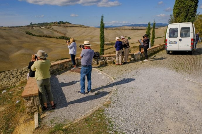 Guests on a photography holiday taking in the Italian landscape