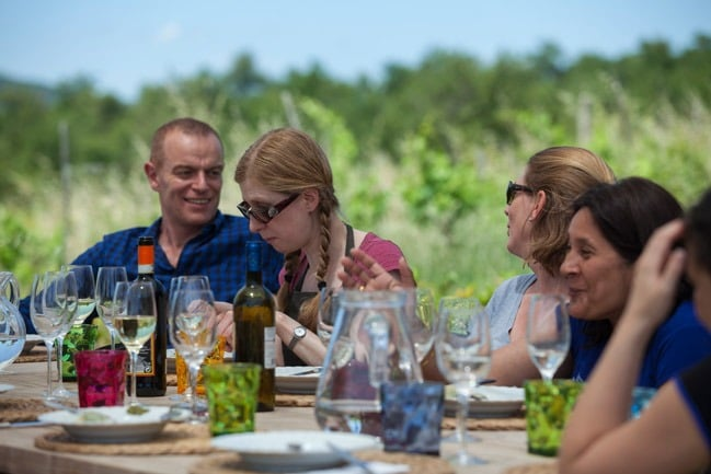 Flavours Holidays guests in Italy eating with wine