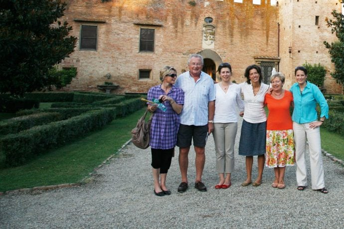 Guests on a language course visiting a historic castle in Italy