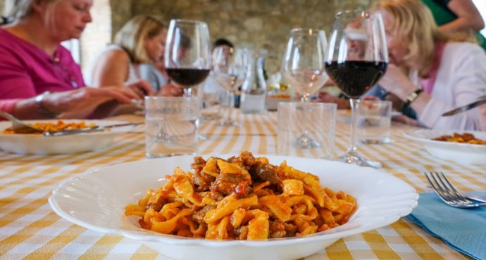 Plate of pasta on table