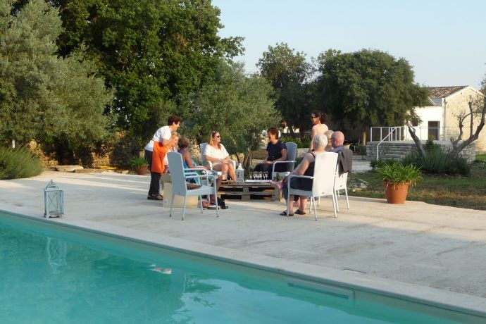 Guests Relaxing Chatting by the Pool