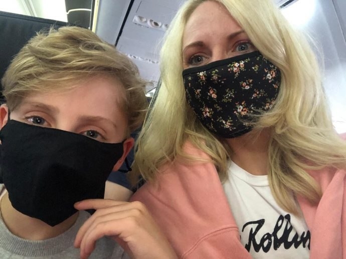 Julie wearing face mask on plane