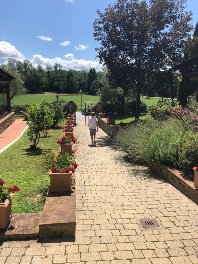 Sunny view of the path and gardens at La Martina