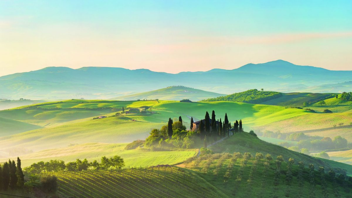 View across foggy rolling hills in Tuscany