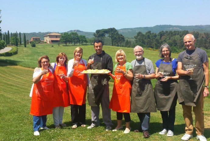 Cooking group pose with their pasta in Italy
