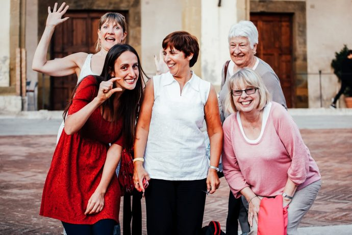 Group of women, of varying ages, laughing and smiling together