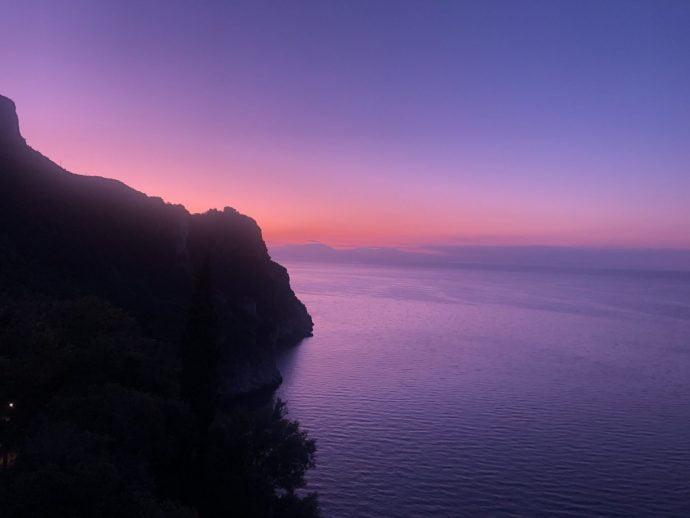 View of the Amalfi Coast as the sun rises over the sea