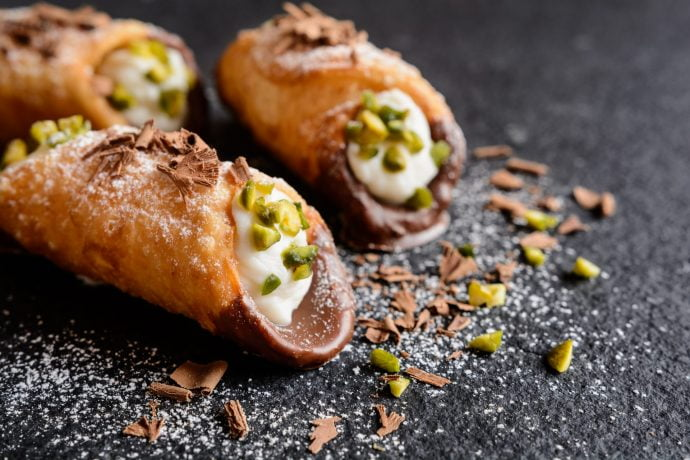 Cannoli di ricotta dipped in chocolate and pistachios