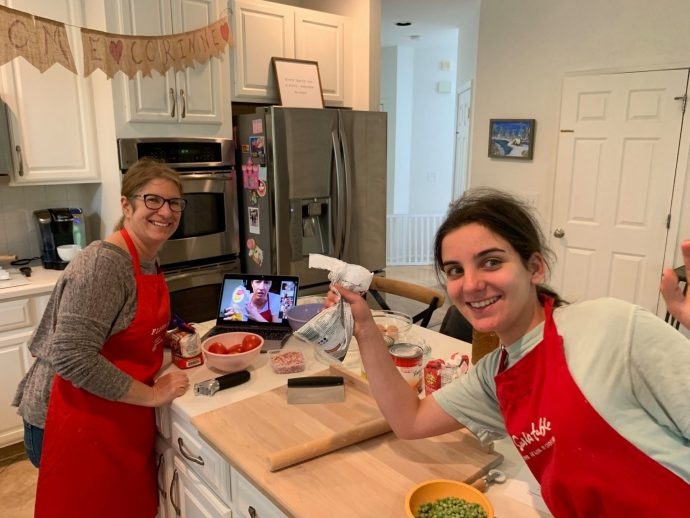 Mother and daughter ready for an online cooking course