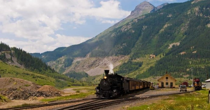 Train going through the highland hills