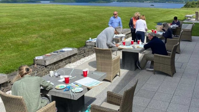 Tutor Mark painting with guests at Loch Lomond