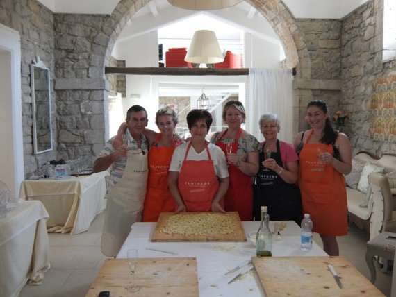 Cooking group in Sicily around table with Italian chef