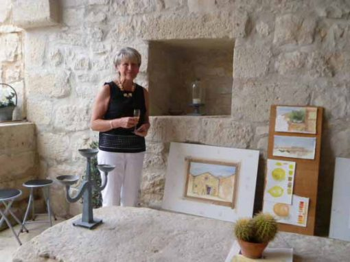 A guest standing next to painting made in on holiday.