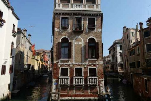 Historic buildings in Venice surrounded by the famous canals