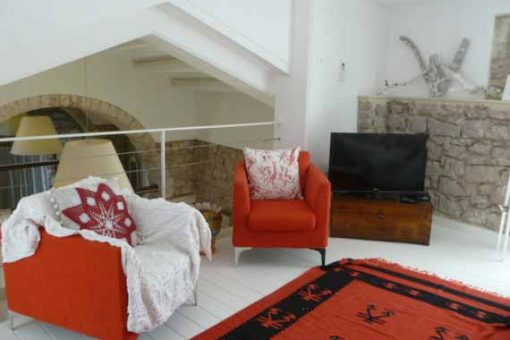 Stylish red furniture in our painting holiday venue in Sicily