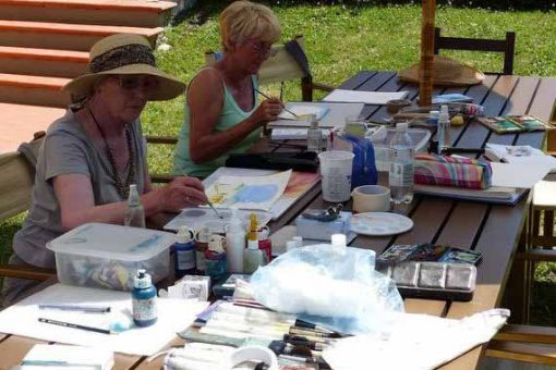 Women painting outside in the garden