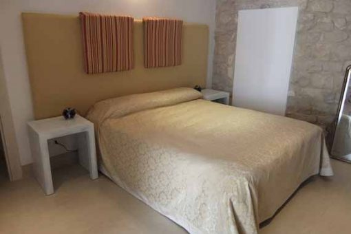 Modern interior of our painting holiday venue in Sicily with stone walls and furniture