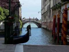 Canal, gondola and buildings in Venice.