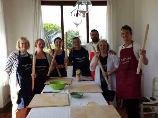 Italian chef with cookery group ready to start their lesson.