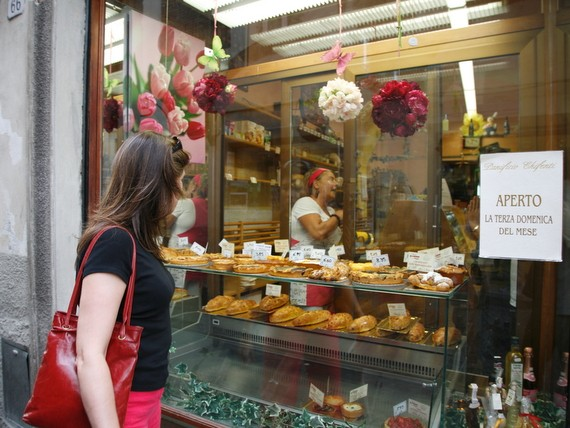 Single traveller looking at delicious Italian food