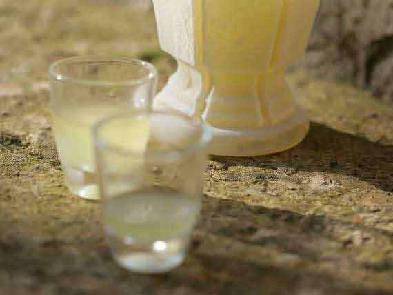 Freshly produced Limoncello with regional lemons.