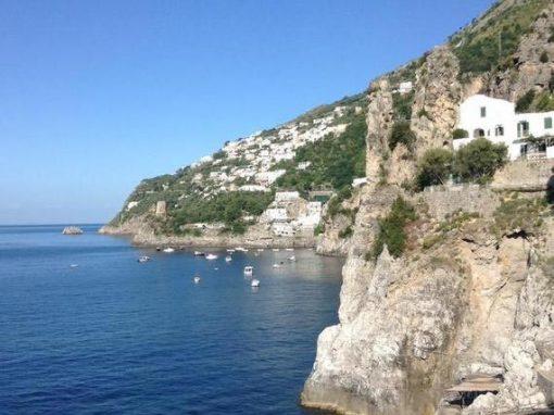 Amalfi coast with blue sky and dramatic cliffs