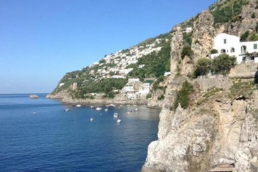 Amalfi coast with blue sky and dramatic cliffs