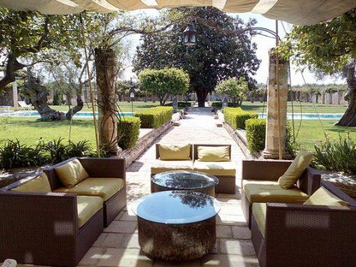Sunny view of venue in Puglia garden and sitting area.