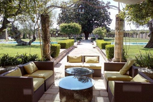 Sunny view of venue in Puglia garden and sitting area.
