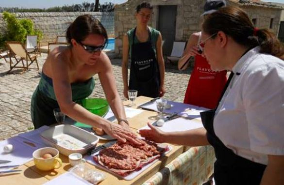 cooking group preparing dishes outside in sicily