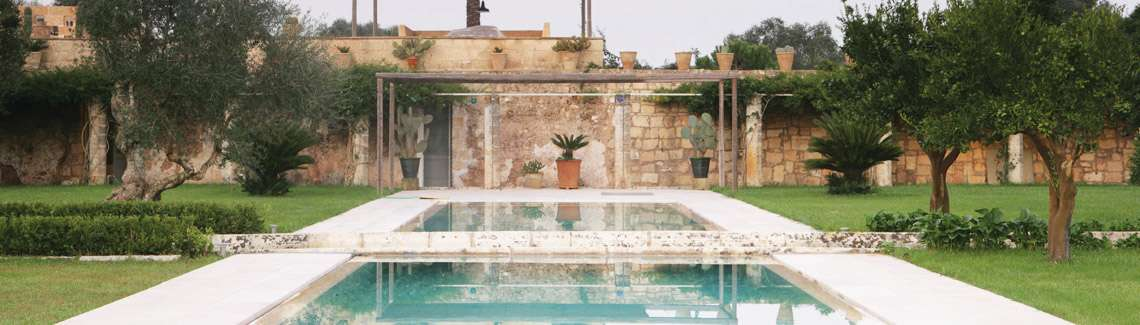 Outdoor pool and garden at our beautiful villa in Puglia.