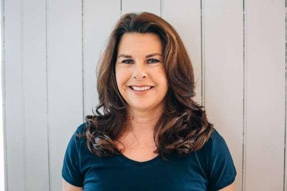 Diane Parrilla, the Pilates instructor in studio on mat exercising Pilates